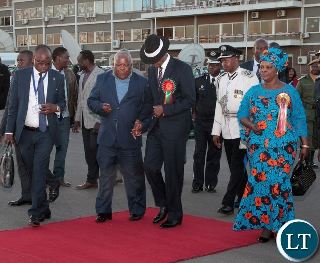Presidential Affairs Minister Freedom Sikazwe(second left) confers with President Edgar Lungu(second right),First Lady Esther Lungu(right) and Presidential Press Aid Amos Chanda(left) at Kenneth Kaunda International Airport as he arrived from Ndola.Picture by Ennie Kishiki/Zanis.