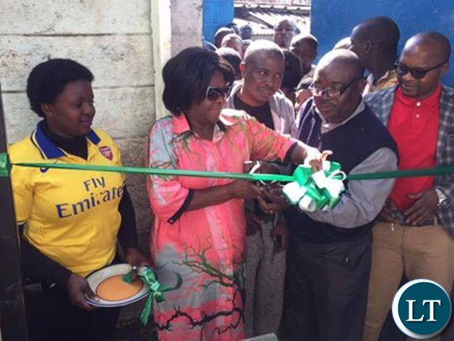 Commerce Trade and Industry Minister Margaret Mwanakatwe cutting the ribbon