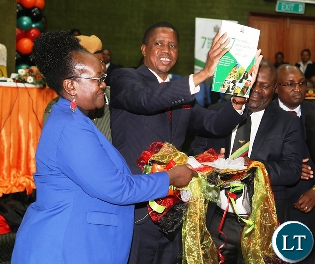 President Edgar Lungu (second from left) cuts the ribbon to officially launch the seventh National Development Plan 2017 to 2021 at Mulungushi Conference Centre.On the middle is National Planning Minister Lucky Mulusa. Picture by SUNDAY BWALYA / ZANIS