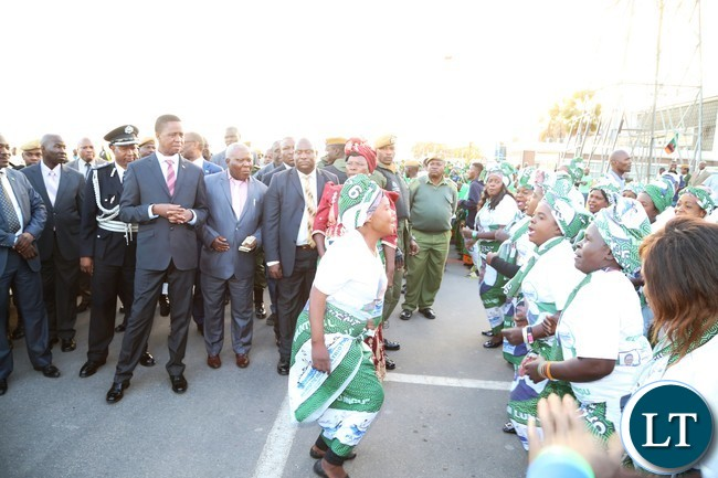PF chair welcomes President Edgar Lungu shortly after his arrival from Lesotho at Kenneth Kaunda International Airport