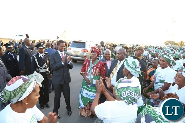 PF chair welcomes President Edgar Lungu who is flanked by Lusaka Province Chairlady Margaret Mumba shortly after his arrival from Lesotho at Kenneth Kaunda International Airport
