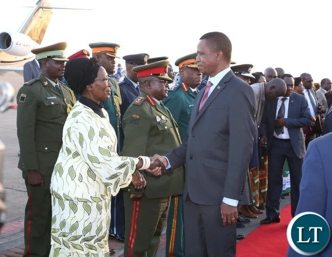Vice President Inonge Wina welcomes President Edgar Lungu shortly after his arrival from Lesotho at Kenneth Kaunda International Airport
