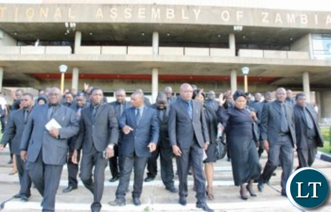 UPND MPs taking the 'walk of shame' out of Parliament after the suspension was announced