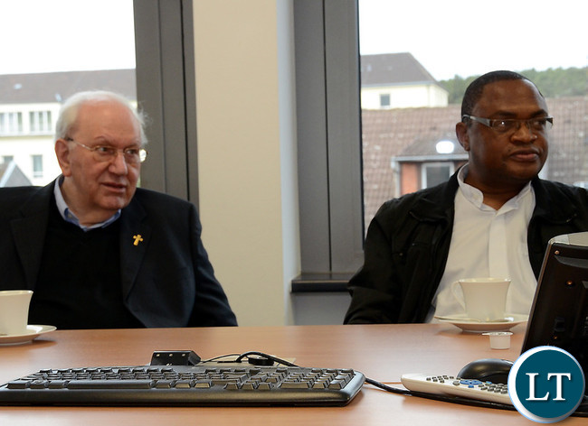 Father Paul Samasumo (L)