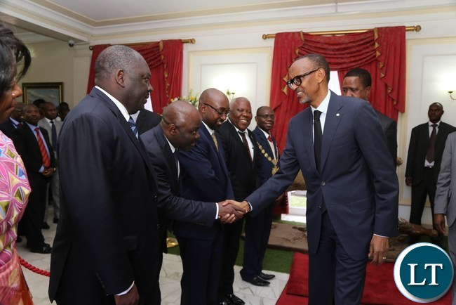 His excellency Mr Paul Kagame President of the Republic of Rwanda greets Home Affairs Minister Steven Kampyongo after the Bilateral Talks at State House