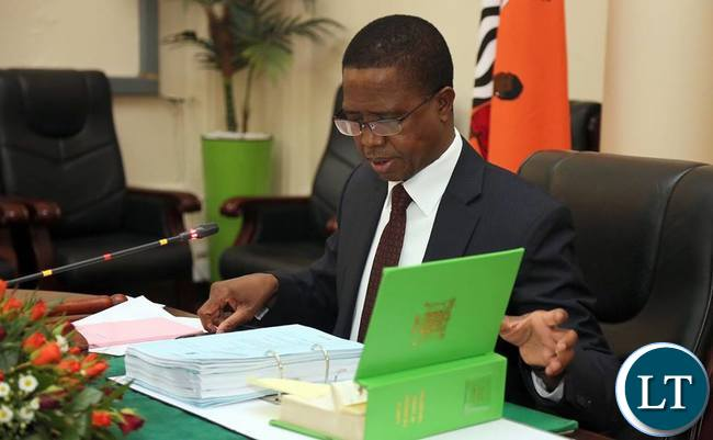 President Edgar Lungu reads the Constitution of Zambia while Chairing a Special cabinet Meeting at State house in Lusaka.