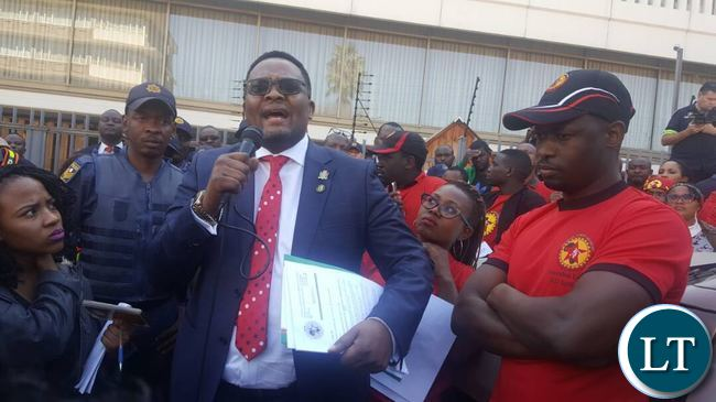 Emmanuel Mwamba speaking when he received a memorandum of demands NUMSA
