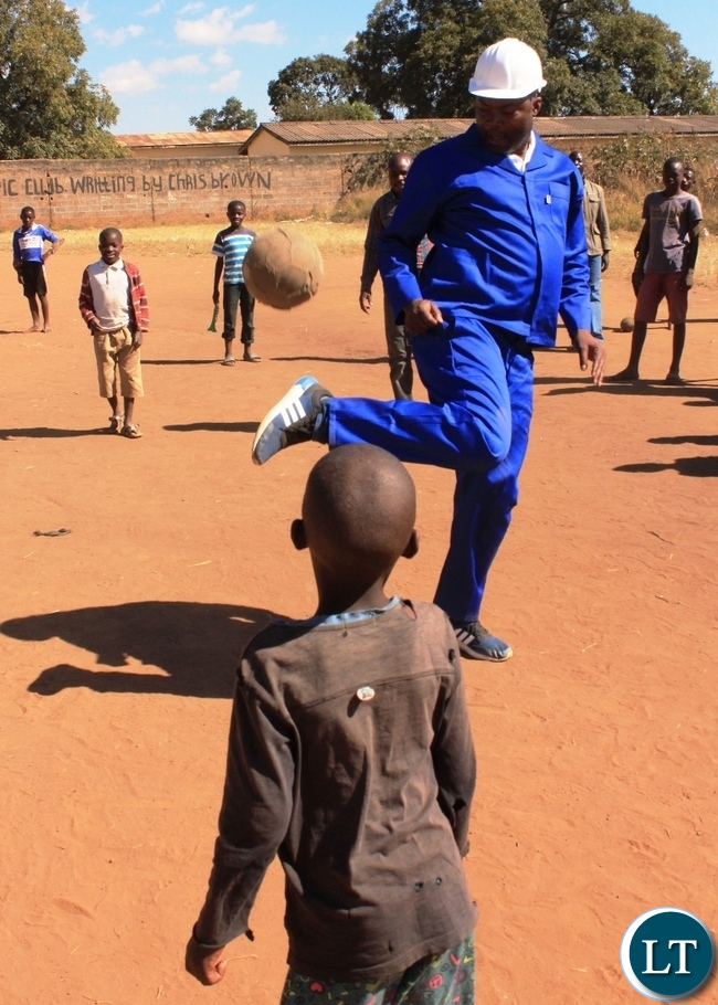 Copperbelt Province Minister, Bowman Lusambo, joins in playing football at Dambo ground in Mine Masala area when he inspected projects in his constituency (Kabushi) in Ndola on Saturday. Picture by TISA BANDA-NKHOMA/ZANIS.