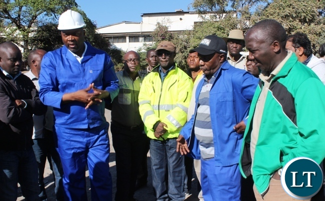 Copperbelt Province Minister, Bowman Lusambo (second from left) accompanied by Senior Chief Chiwala (in black cap) talks to stakeholders upon flagging off the rehabilitaion of the Chiwala road in Ndola on Saturday. Picture by TISA BANDA-NKHOMA/ZANIS.