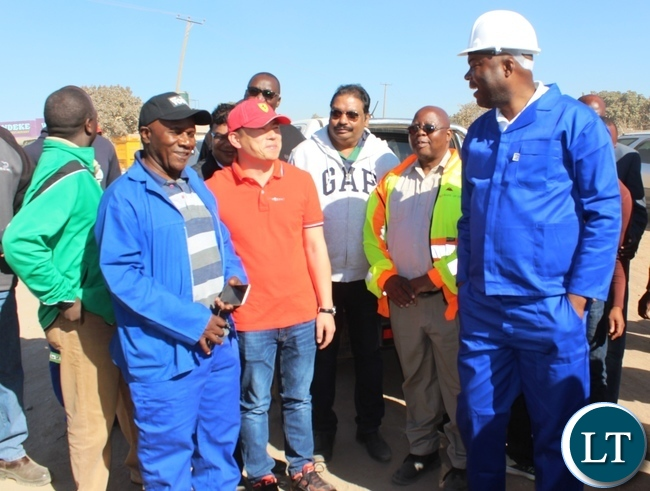 Copperbelt Province Minister, Bowman Lusambo (right) accompanied by Senior Chief Chiwala (in black cap) talks to stakeholders and investors upon flagging off the rehabilitaion of the Chiwala road in Ndola on Saturday. Picture by TISA BANDA-NKHOMA/ZANIS.