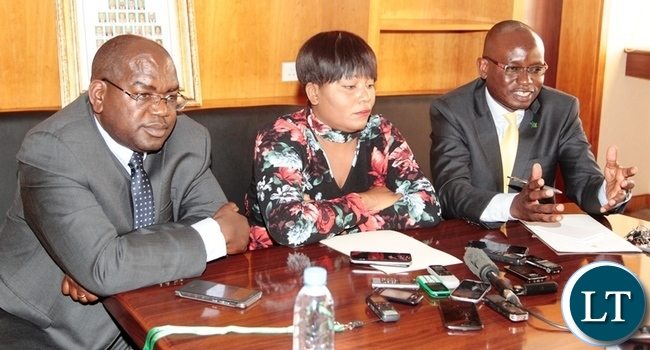 President Edgar Lungu's Press Aid Amos Chanda (left) stressing a point during a press briefing which was held at Government complex in Lusaka.Looking on (middle) is Information and Broadcasting Services Minister, Kampamba Mulenga and Health Minister DR Chitalu Chilufya (right). Picture by SUNDAY BWALYA/ ZANIS