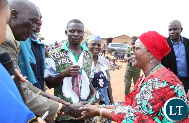 First Lady Esther Lungu  greets Petauke residents during the Commissioning of  a borehole donated to Esther Lungu Foundation Trust by Nyimba Investments at Ndewe Village in Chief Kalindawalo's Chiefdom on Sunday, August 20,2017-Picture by THOMAS NSAMA/STATE HOUSE