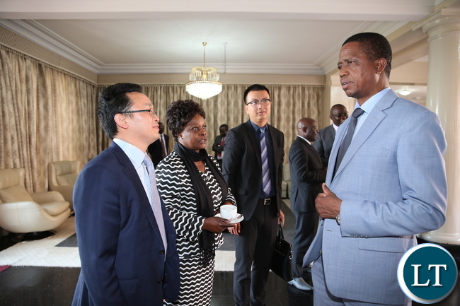 President Lungu (R) speaks with Huawei Technologies Zambia Managing Director Thomas Hu (L) as Huawei Public Relations Manager Hansen He at State House where Huawei donated Computers to Esther Lungu Foundation Trust on August 14,2017-Pictures by THOMAS NSAMA