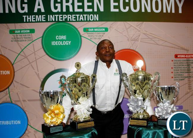 FILE: ZESCO Senior Corporate Affairs Patrick Mwila displaying awards won by the power utility.