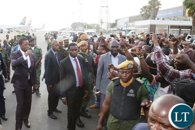 President Edgar Lungu wave the party symbol to the PF members shortly after his arrival from United Nations (USA) Annual General Assembly Meeting at Kenneth Kaunda International Airport