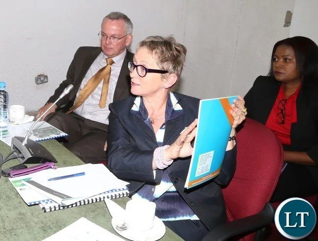 Ina Ruthenberg world Bank Country Manager- Zambia showing the book to Parliamentary Accounts Committeduring during the meeting with Parliamentary Accounts Committee at Parliament