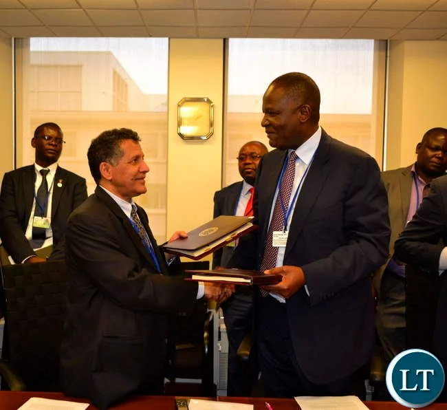 Finance Minister Felix Mutati with Vice Chairman of The Arab Bank for Economic Development in Africa Yousef Al-Bassam,