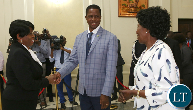 President Edgar Lungu greets Mrs Cecilia Mbewe Clerck of the National Assembly looking on is Vice President Mrs Inonge Wina at State house