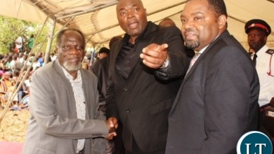 Copperbelt Province Minister, Bowman Lusambo chats with former Minister of Defence, George Mpombo (left) and Mpongwe District Commissioner, Keith Maila (right) at the burial of former Cabinet Minister in Kenneth Kaunda's government, Cosmas Chibamba at Nakatungu Farm in Mpongwe District on Friday. Picture by TISA BANDA-NKHOMA/ZANIS.