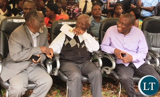 Former Minister of Defence, George Mpombo (left) chats with former Deputy Minister of Foreign Affairs, Gabriel Namulambe (right) at the burial of former Cabinet Minister in Kenneth Kaunda's government, Cosmas Chibamba at Nakatungu Farm in Mpongwe District on Friday. Picture by TISA BANDA-NKHOMA/ZANIS.