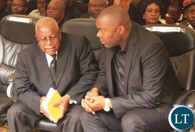 Copperbelt Province Minister, Bowman Lusambo confers with former Secretary to the Cabinet, Leslie Mbula (left) at the burial of former Cabinet Minister in Kenneth Kaunda's government, Cosmas Chibamba at Nakatungu Farm in Mpongwe District on Friday. Picture by TISA BANDA-NKHOMA/ZANIS.