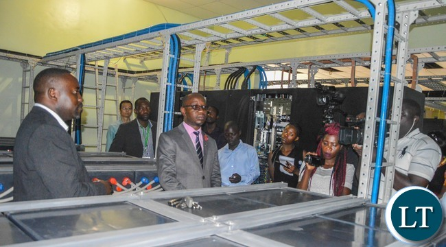 Zamtel Acting Chief Technical Officer Freelance Bwalya explains to Journalists details of the ongoing upgrade and modernisation of the Zamtel network during a media tour on Tuesday, November 2017