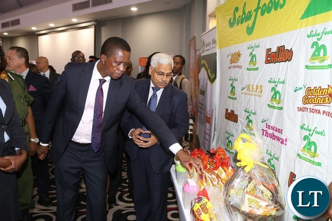 President Edgar Lungu flanked by Seba Foods Managing Director Ram Ray Vijayvargiya during the tour of stands at the Zambia Association of Manufactures symposium at Radisson Blue Hotel