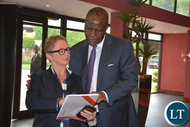 World Bank Country Manager Ina Ruthenberg explains on the book called Zambia Economic Brief to Minister of Finance Felix Mutati shortly before the World Bank Launches of the tenth of Zambia Economic Brief at Pamondzi Hotel