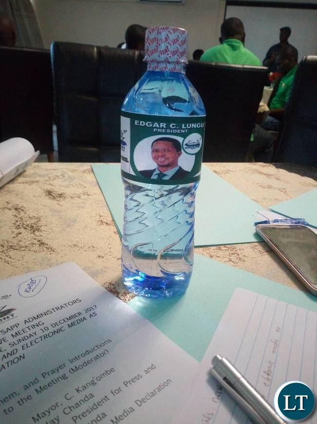 Edgar Lungu branded water bottle during the workshop