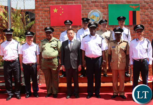 Zambia Police staff reserve in Charge Superintendent Kayombo Chimwanga, Zambia Police reserve Senior Superintendent Wu Ming, ZP Deputy IG Malcolm Mulenga, Chinese Embassy to Zambia Director Zhao Ming, Zambia Police IG Kakoma Kanganja, Zambia Police Lusaka Division Commander Nelson Phiri and Zambia Police reserve Assistant Commissioner Zhang Ming,