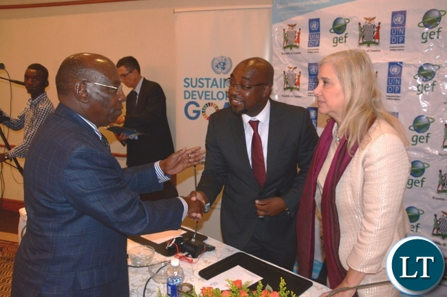 World Meteorological Organisation (WMO) Representative for Eastern and Southern Africa based in Nairobi-Kenya Stephen Njoroge confers with Minister of Transport and Communication Brian Mushimba whilst Manager CIRDA-Programme UNDP Dr. Bonizella Biagini looks on shortly after the official opening of UNDP regional workshop on Sustainability for Climate Information Services at Pamodzi Hotel
