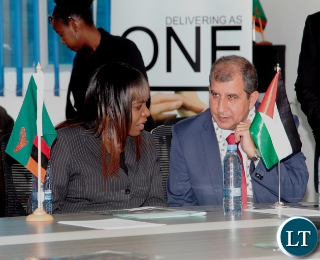Acting Director Zambia Mine Action in the Ministry of Foreign Affairs  Mrs Dyriss Simasiku (left) talking to the Palestinian  Ambassador to Zambia Dr Walid Hasan during the International day for the solidarity of the Palestinian People held at the International Labour Organisation Offices in Lusaka.