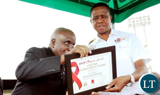"President Edgar Lungu joins the commemoration of World Aids Day at Nkoloma Stadium in Lusaka where he honoured First President of Zambia Dr Kenneth Kaunda with the ""Lifetime Achievement Award, "" on Monday, 11th December, 2017. Pictures by Eddie Mwanaleza, State House."