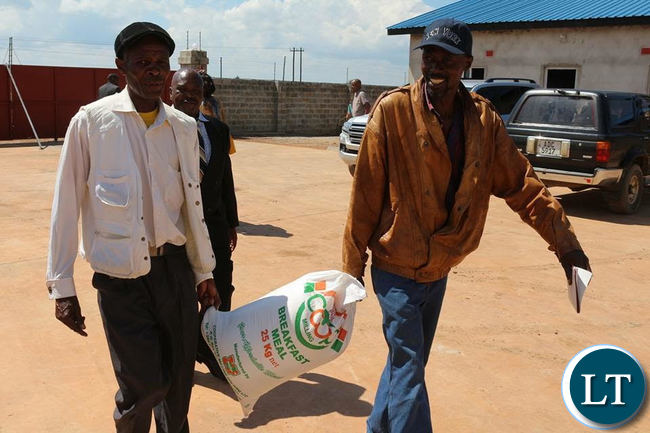 Some residents walking away with a 25 Kg mealie meal bag