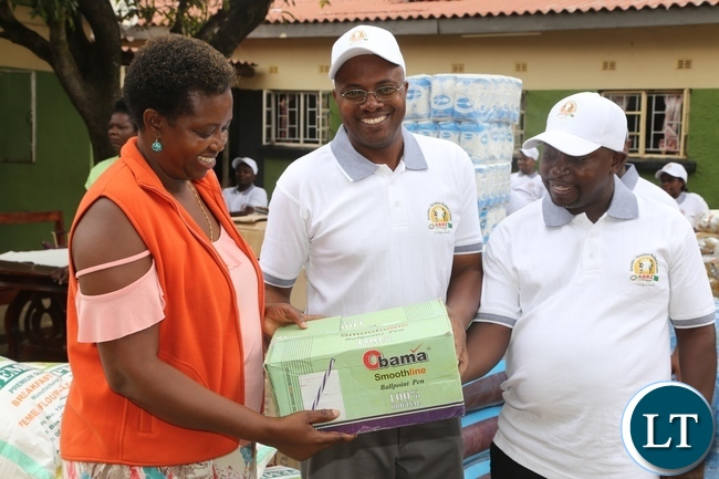 The founder of Kabwata Orphanage Angela Miyanda receives the donation from Association of Burundian Residents In Zambia Vice Chairperson Emile Masabarakiza (2nd) with his Chairperson Dieudonne Baranzira handing over the donated goods to Kabwata Orphanage goods worth K 30,000 during the donation
