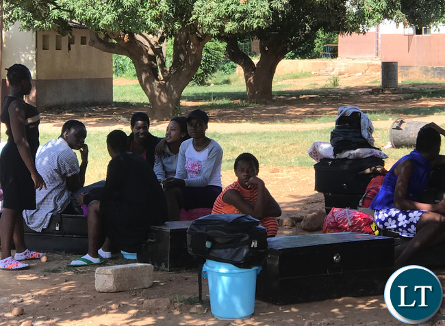 Chongwe's Mukamambo Girls Boarding School pupils waiting for transport back home after the school was abruptly shut