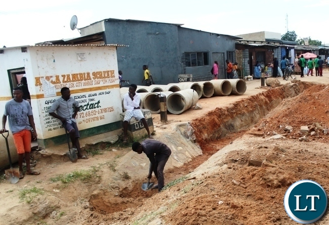 Workers contracted by Serenje town council working on the drainage system at the Serenje bus station to improve the drainage system. The measure will help in preventing an out-break of Cholera in the district.