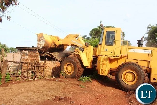 AN Illegally built waterborne toilet at one of the residences in Chipata is being demolished to curb the spread of cholera. The toilet is also alleged to have been illegally connected to the sewer line of the Eastern Water and Sewerage Company. PICTURE BY STEPHEN MUKOBEKO/ZANIS