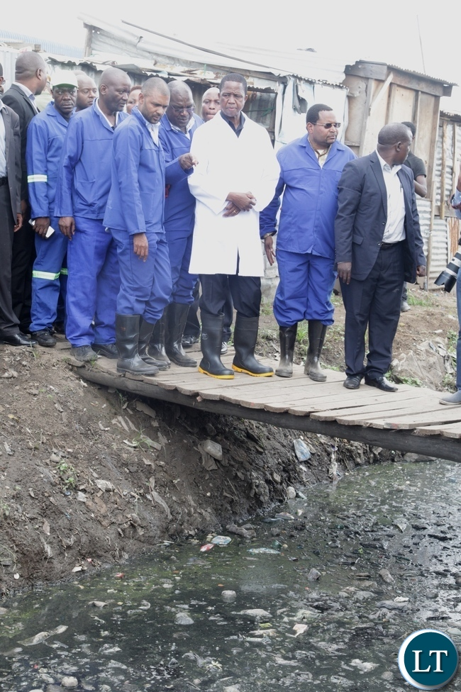 President Edgar Lungu listens to Health Minister Dr Chitalu Chilufya when he toured city market .looking on is Local Government Minister Vincent Mwale and Water and Sanitation Permanent Secretary Eddie Chomba