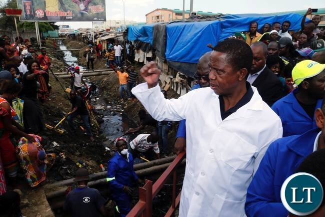 President Edgar Lungu salutes people as he inspects the cleaning operations conducted by the defence forces at City Market in Lusaka on Sunday,December 31,2017. PICTURE BY SALIM HENRY/STATE HOUSE ©2017