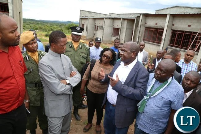 Health Minister Chitalu Chilufya briefs President Edgar Lungu after they toured Mafinga District Hospital which is under construction in Muchinga Province