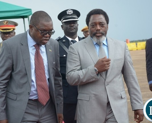 President Joseph Kabila confers Foreign Affairs Minister Joseph Malanji shortly before his departure at Kenneth Kaunda International Airport