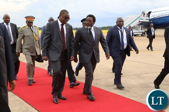 Foreign Affairs Minister Joseph Malanji flanked by President of the Democratic Republic of Congo His Excellency Mr.Joseph Kabila at Kenneth Kaunda International Airport.