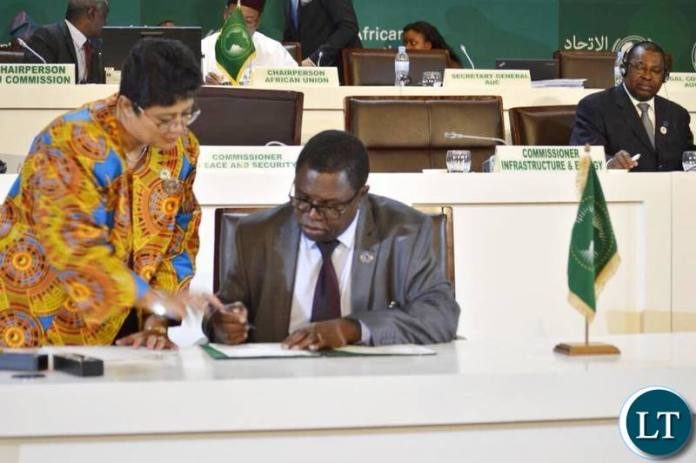 Foreign Affairs Minister Joe Malanji signing the declaration in Kigali, Rwanda