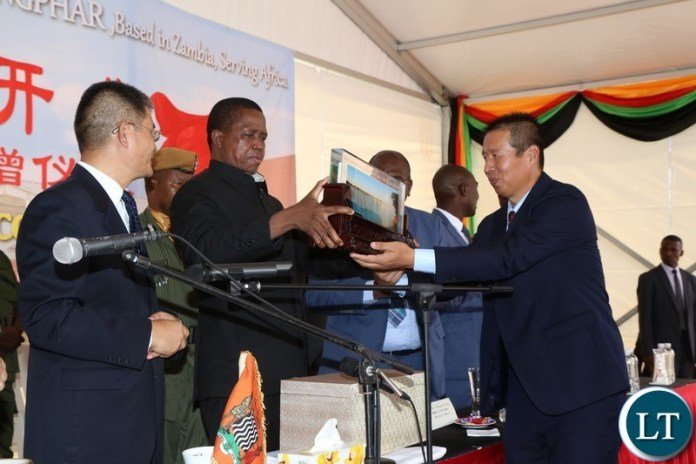 President Edgar Lungu receives a gift from Kingphar Zambia Limited General Manager Mr.Wang Shunxue during the commissioning of the Pharmaceutical Plant in Lusaka