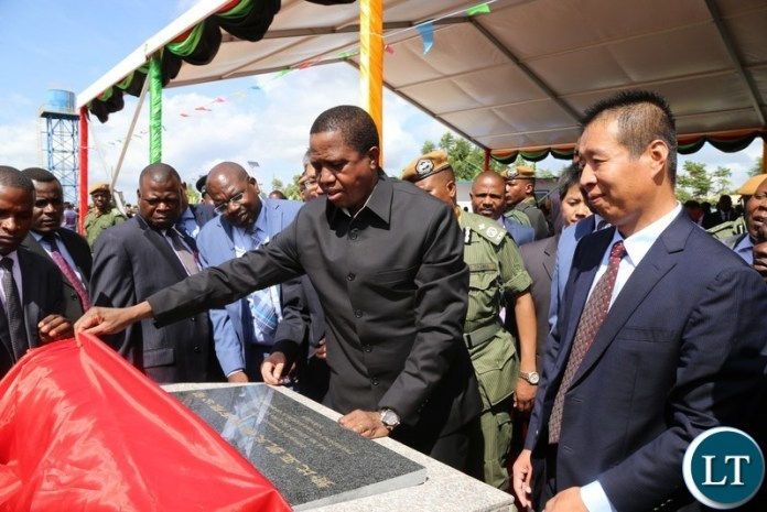 President Edgar Lungu unveils a plaque to officially Commission a Pharmaceutical plant while Kingphar Zambia Limited General Manager Mr.Wang Shunxue looks on in Lusaka