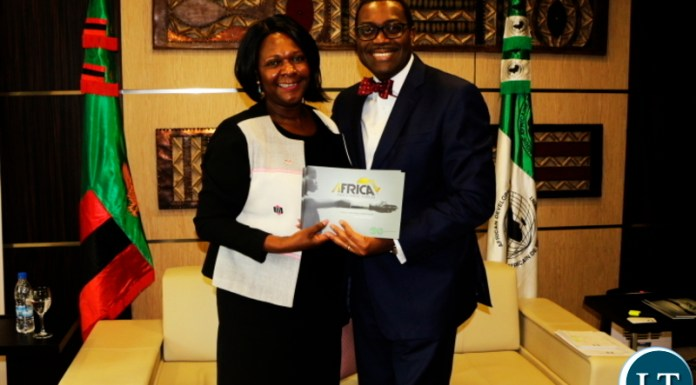 Dr. Adesina and Minister Mwanakatwe pose for a photo @ the AfDB HQ in Abidjan CIV.