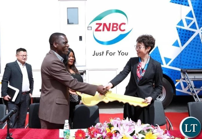 Zhao Yueqin, Vice President of StarTimes Group hands the key of OB and DSNG vans to Beaton Kaluba MIBS Planning and Information Director