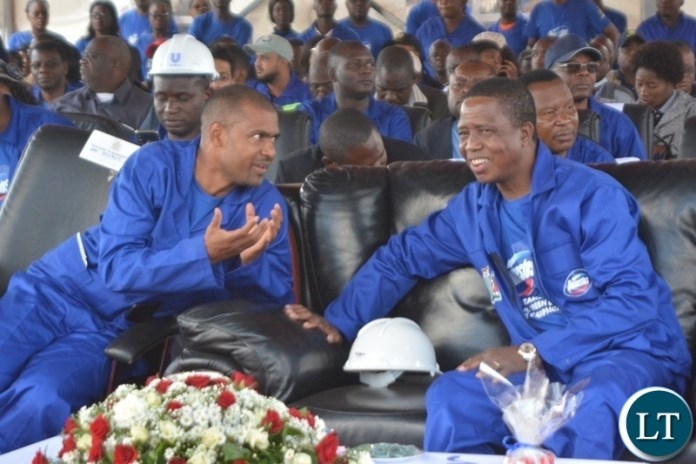 President Edgar Lungu confers with Minister of Local Government,Vicent Mwale during the re-launch keep Zambia clean Campaign at Soweto marke