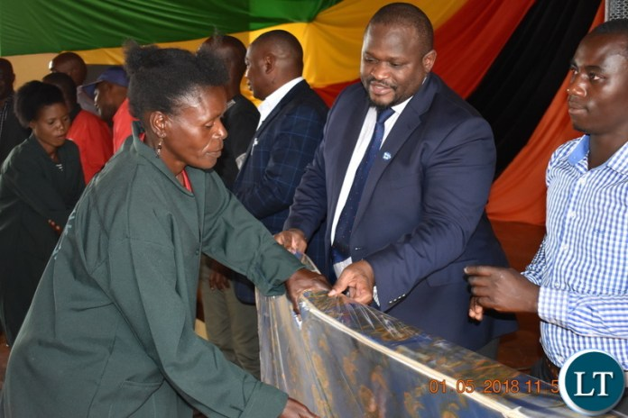 Minister of National Development Planning Alexander Chiteme handing over awards to various recipients on behalf of Government institutions and private sector companies during the Labour Day Celebrations in Mbala on 1 May 2018. – PHOTO | CHIBAULA D. SILWAMBA | MNDP